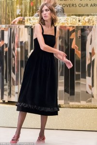 Alexa Chung dresses in a chic black pinafore for her new ...