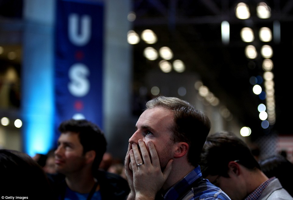 Hold your head: A candidate clasps his face as states successively rejected Clinton