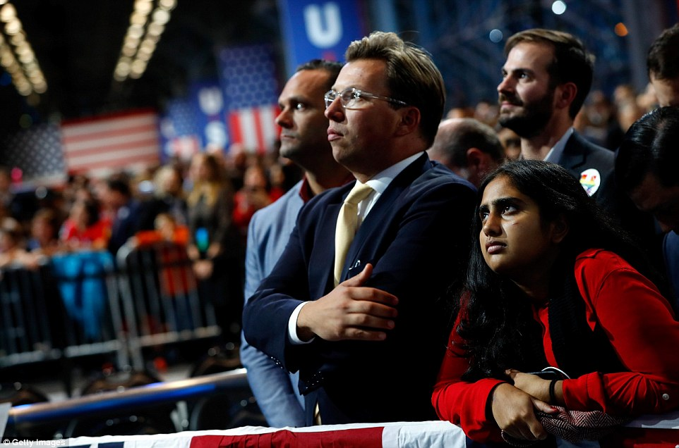 Going down: Clinton supporters in New York's Javits Center steeled themselves as their candidate continued to fall