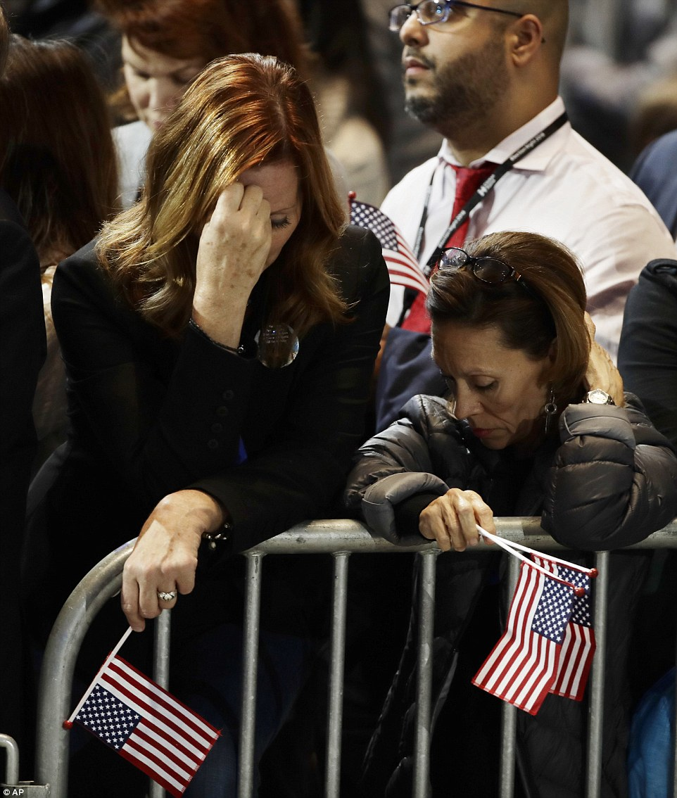 Flagging: Supporters didn't even have the energy to wave their flags as support for Clinton continued to fall