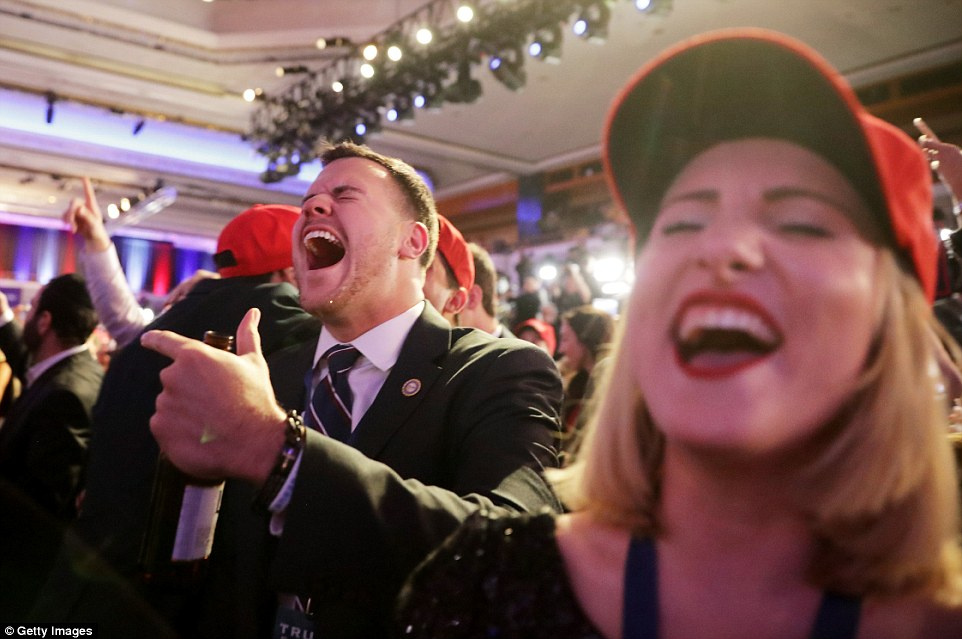 Jubilation: The vibe in the Trump party, just two miles away from the Clinton event, was a lot brighter, with cheering and chants of 'lock her up' as their candidate continued to sweep across America