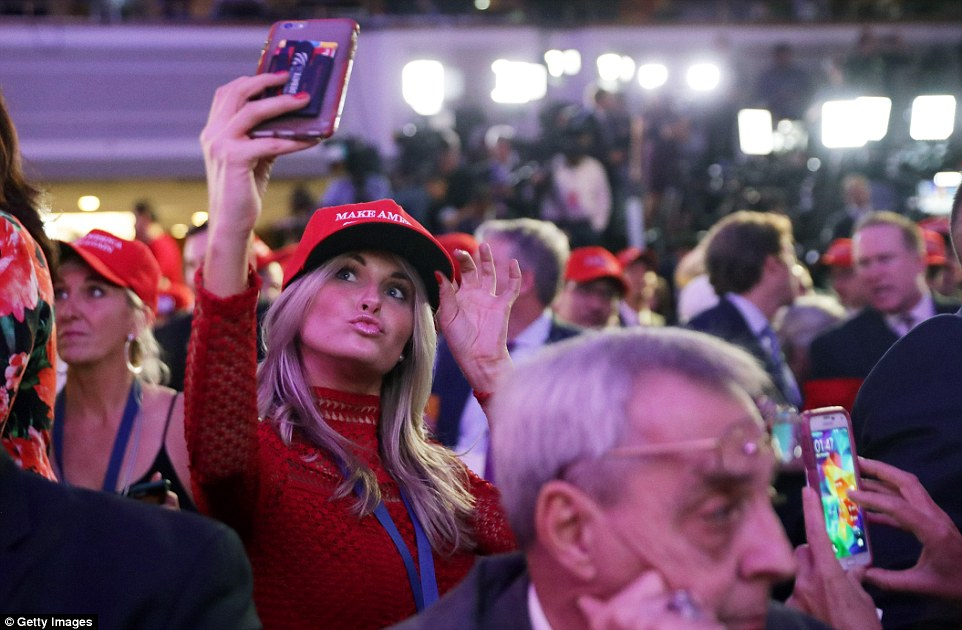 Strike a pose: A Trump supporter poses with her 'Make America Great Again' hat in the New York Hilton party