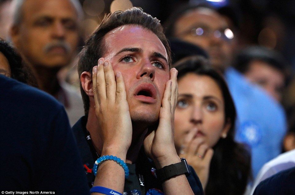 Disbelief: This Clinton voter didn't seem to believe that his favored candidate's campaign had failed - and the Clinton campaign followed suit, refusing to concede early Wednesday morning