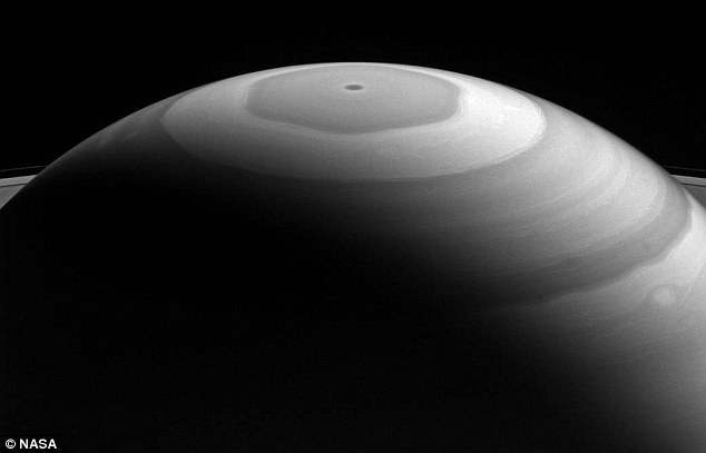 This stunning new image reveals the massive hexagonal storm at Saturn's North Pole, and its gigantic rings.Each latitudinal band represents air flowing at different speeds, and clouds at different heights, compared to neighboring bands.