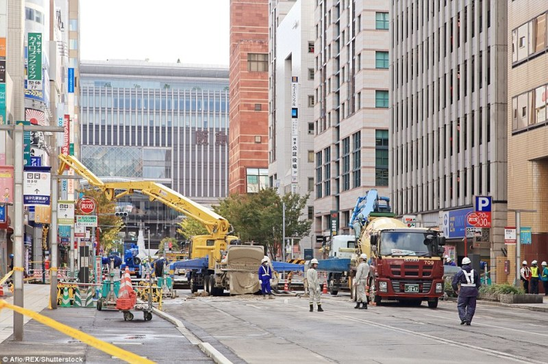 Construction teams worked around the clock to repair the damage to the road following the sudden collapse