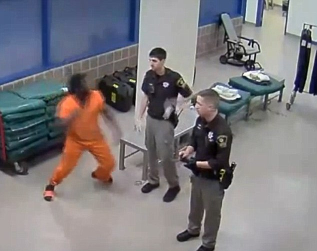 The moment a teenage prisoner beat up a corrections officer - but he