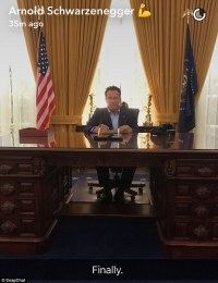Arnold Schwarzenegger sits at replica of Richard Nixon's ...
