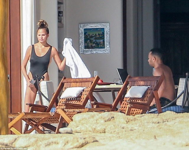 Ready to take a dip:The stunner was spotted on Monday with her husband John Legend enjoying the sun and sand at the beach hot spot