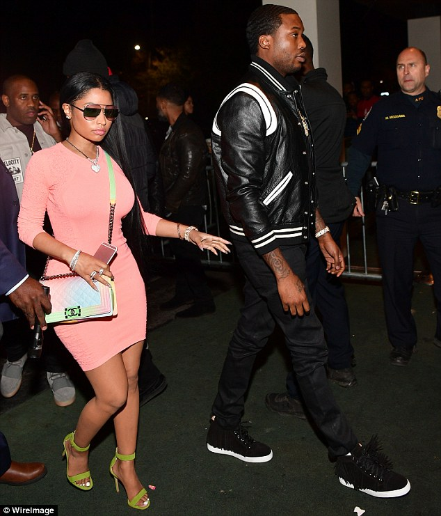 Absolutely flawless: Nicki Minaj made sure to stand out in the crowd with her candy colored ensemble while arriving to the Gold Room in Atlanta with boyfriend Meek Mill on Friday