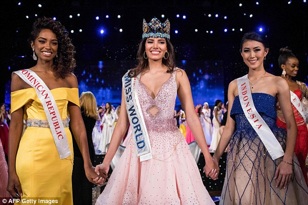Champions: Miss Del Valle and her runners upbeat entrants from more than 100 countries in the pageant which was held at the MGM National Harbor in Oxon Hill, Maryland