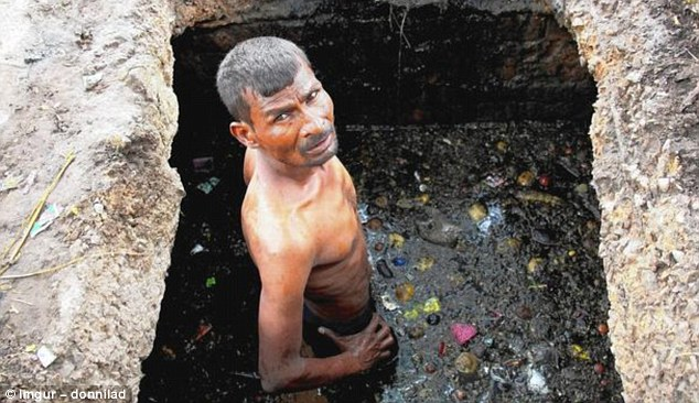 The Imgur user who shared this image said it depicts an Indian sewer worker, who is wearing no protective clothing despite being waist deep in the tunnel