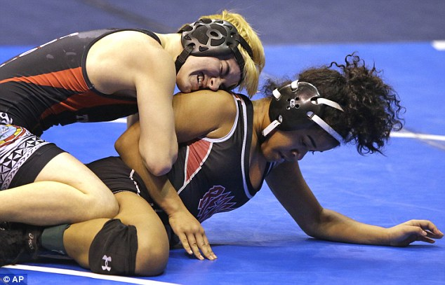 Mack Beggs, (left) a transgender wrestler from Texas, won a quarterfinal match after competing against Mya Engert on Friday (right)