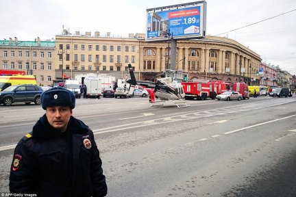 Emergency vehicles and a helicopter are seen at the entrance to Technological Institute metro station in St Petersburg on April 3, 2017