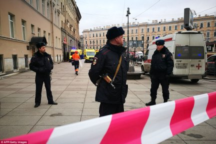 Police officers guard the area at the entrance to Technological Institute metro station in St Petersburg on April 3, 2017