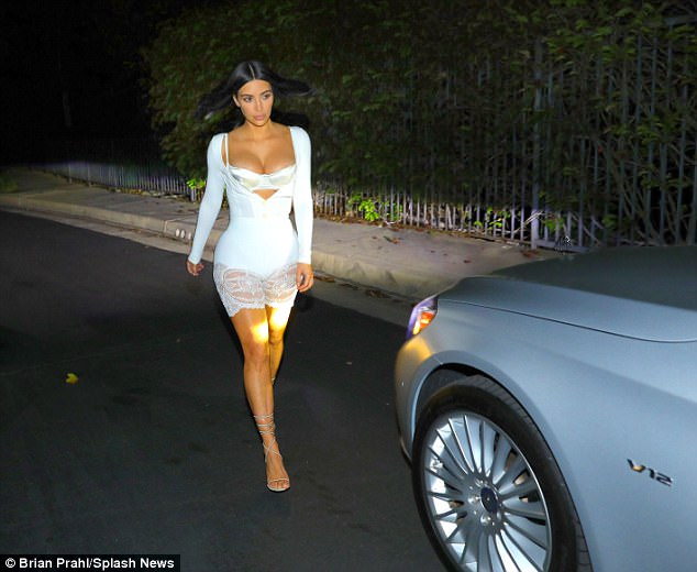 All of the lights: The car's headlights proved the perfect spotlight for Kim's sidewalk strut