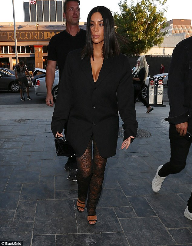 Staying safe: Kim Kardashian made sure to bring a bodyguard as she stepped out in Hollywood on Tuesday night with her pal Jonathan Cheban by her side