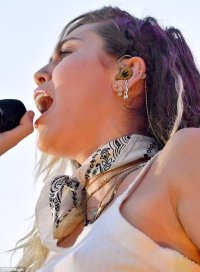 Miley Cyrus wears earring that reads 'LIAM' at Wango Tango ...