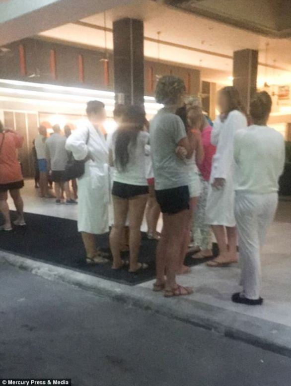 Guests outside the Riu Reggae Hotel after the explosion in the early hours of the couple's first night