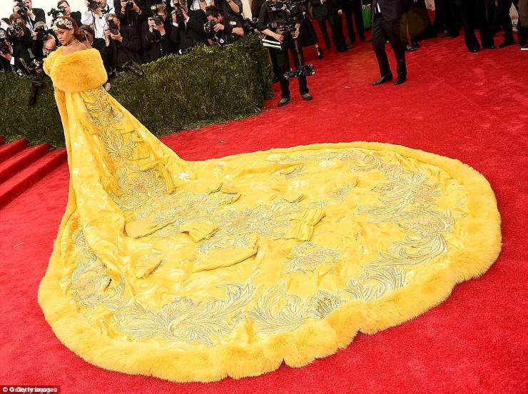 Way back when:The yellow gown had echoes of the famous dress she wore for the 2015 Chinese-themed Met Gala bash in New York, where she quite literally shut down the red carpet in a huge yellow gown - by Chinese couture designer Guo Pei - that left little space for anyone else