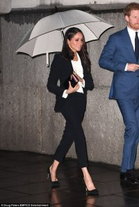 Meghan Markle wears a tailored suit to black tie event ...