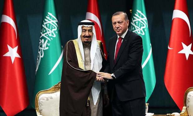 Turkish President Recep Tayyip Erdogan (R) shakes hands with King Salman of Saudi Arabia after the Saudi monarch received Turkey's highest state medal during a ceremony at the presidential complex in Ankara on April 12, 2016. —AFP