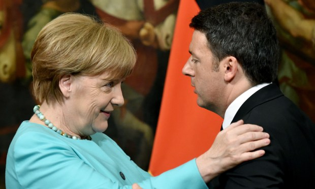 Rome: Italian Prime Minister Matteo Renzi with German Chancellor Angela Merkel after a press conference at Palazzo Chigi on Thursday.—AFP