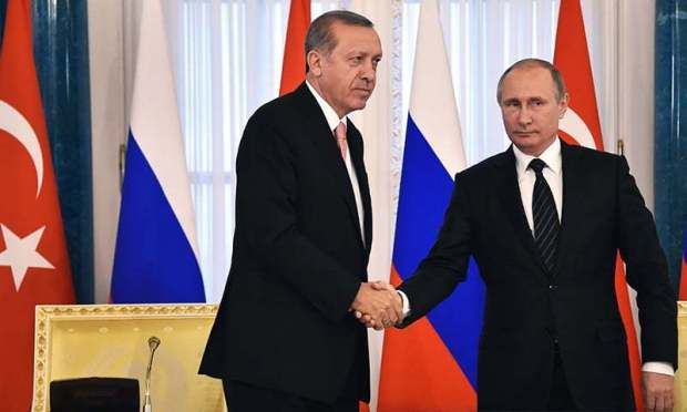 Russian President Vladimir Putin shakes hands with his Turkish counterpart Recep Tayyip Erdogan  during their press conference in Konstantinovsky Palace outside Saint Petersburg. -AFP