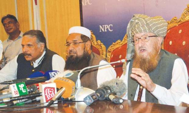 ISLAMABAD: Defence of Pakistan Council chief Maulana Samiul Haq addresses a press conference on Wednesday.—White Star