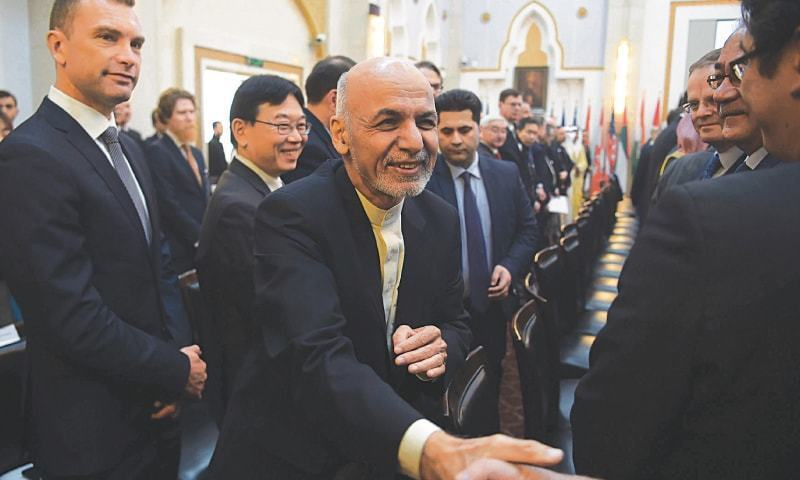 Afghan President Ashraf Ghani shakes hands with a foreign delegate during the Kabul Process conference at the Presidential Palace. — AFP/File photo