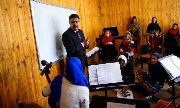 Ahmad Naser Sarmast, head of Afghanistan's National Institute of Music, speaks to members of the Zohra orchestra. ─ Reuters