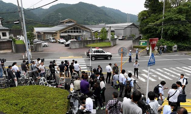 Journalists gather in front of the Tsukui Yamayuri En care centre.— AFP