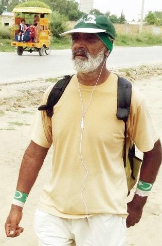 Abid Nisar, 60, walks to Chakwal from his village, Chak Norang.
