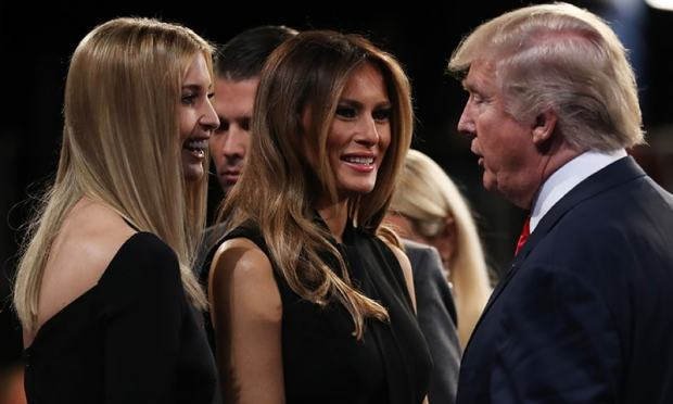 Trump is cheered by his wife Melania Trump (C) and daughter Ivanka Trump (L) at the end of the final presidential debate.— AFP