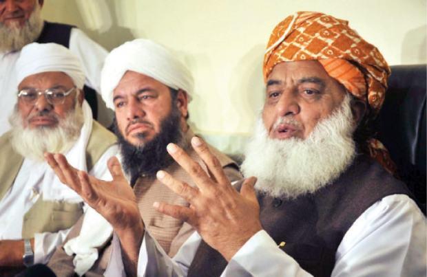 Maulana Fazlur Rehman addressing a press conference in Peshawar on Thursday. — White Star