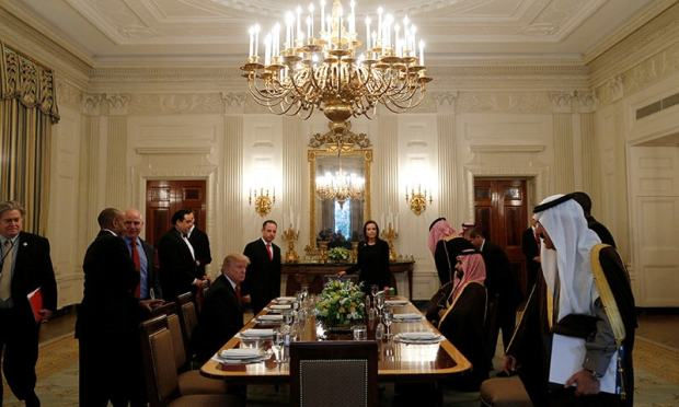 Trump and Saudi Deputy Crown Prince take their seats for lunch in the State Dining Room of the White House.— Reuters