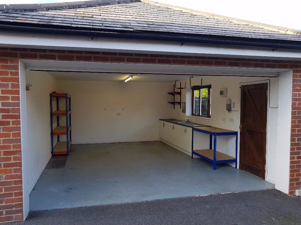 Secure Double Garage For Use As Workshop Storage Unit In