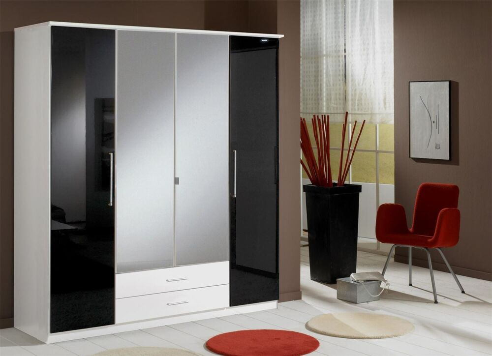 Armoire Dressing 4 Portes German 4 Door Black Gloss And White Mirror Wardrobe New | Ebay