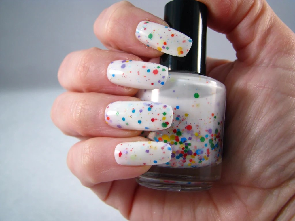 Galactose Intolerance White And Rainbow Glitter Nail