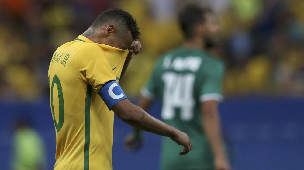 Neymar of Brazil reacts after their draw to Iraq