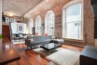 Brick barrel vaulted ceiling and 12-foot windows in this ...