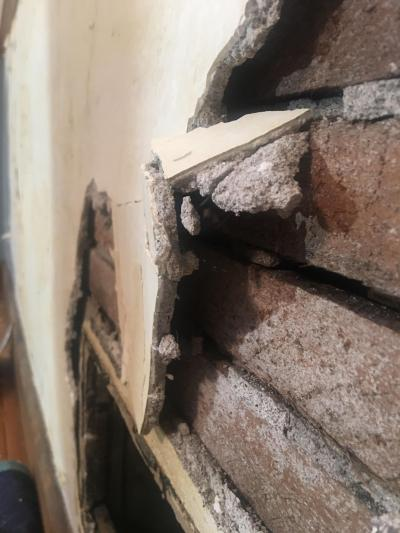 Is this asbestos in my wall? Remodeling my house. House is built in 1907. We don't appear to ...