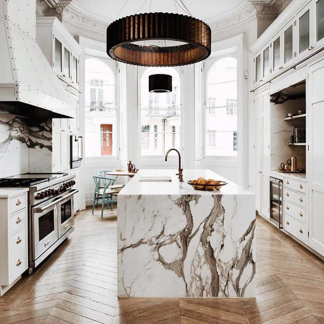 White Marble Kitchen Floors White Marble Kitchen With Herringbone Wood Floors In
