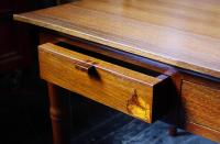 A 'human' sized walnut coffee table. Drawer detail ...