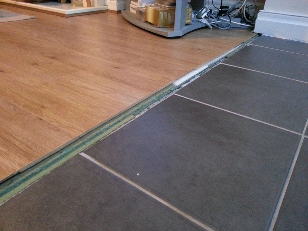 how can i transition between these floors laminate kitchen flooring enter image description here