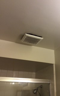 bathroom - Is it normal for an exhaust fan cover to hang ...