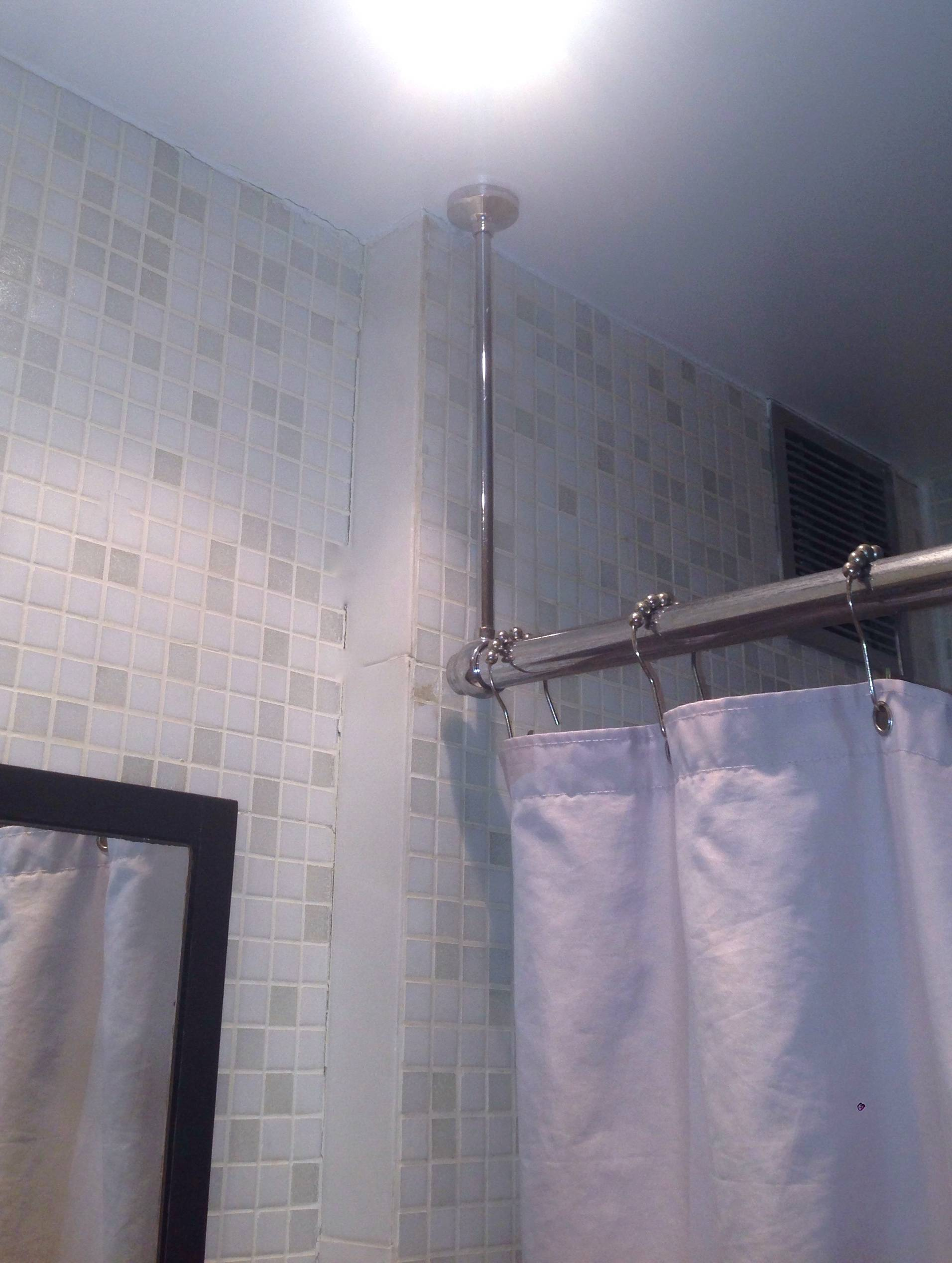 shower curtain rod bracket to ceiling hole what it should look like