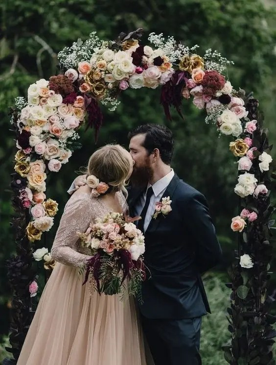 luxurious moody arch with dark and blush flowers