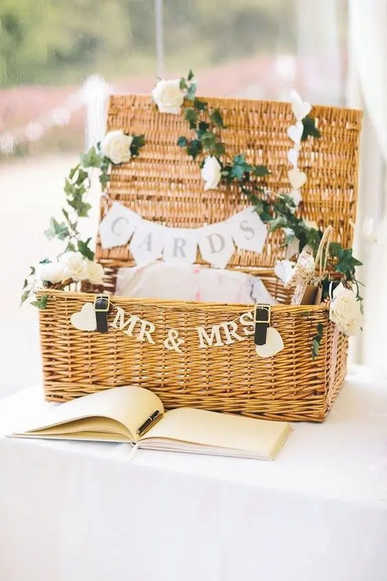 a cool basket decorated with a banner and white roses