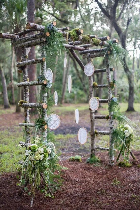 birch branch arch with greenery and lace dream catchers fits a boho woodland wedding