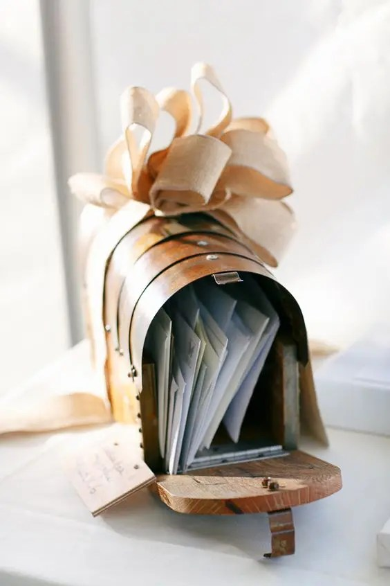 mailbox for cards topped with a burlap bow